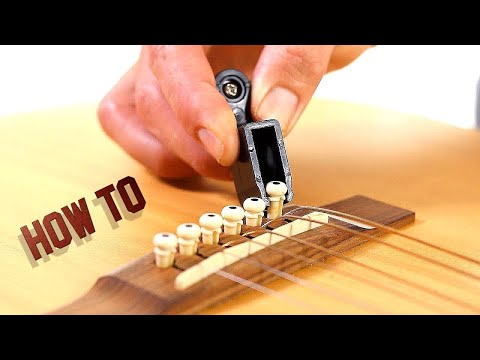 How to Remove Guitar Strings - Acoustic Guitar Maintenance