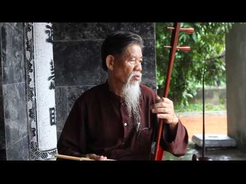 Vietnamese Monk playing traditional instrument #2