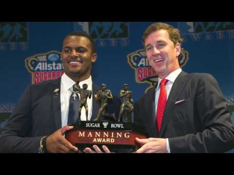 Quarterback Deshaun Watson is presented the Manning Award by Cooper Manning