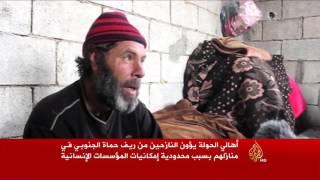 معارك ريف حماة الجنوبي تجبر آلاف المدنيين على النزوح