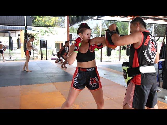 Lena Nocker working elbows with Kru Sawat