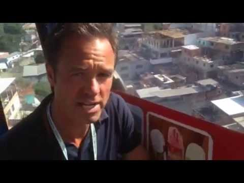 5 News in Rio - Cable car ride above huge favela