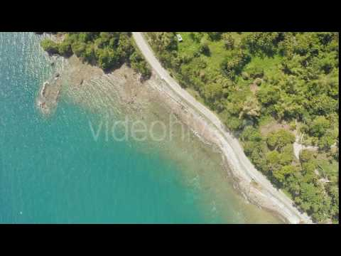 Curve winding road along the coast of the Philippines. Aerial views