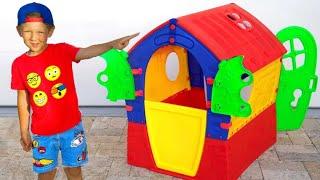 Senya and his new House for Children. Senya plays the Builder