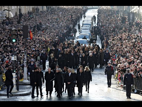 Thousands gather in Paris for French rock legend's funeral