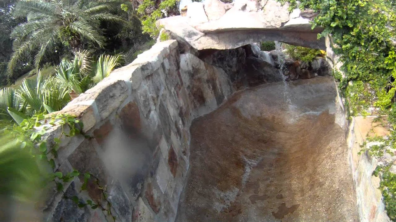 Jump Off The Natural Stone Grotto Waterfall And Slide Under A Waterfall  Into The Swimming Pool   YouTube