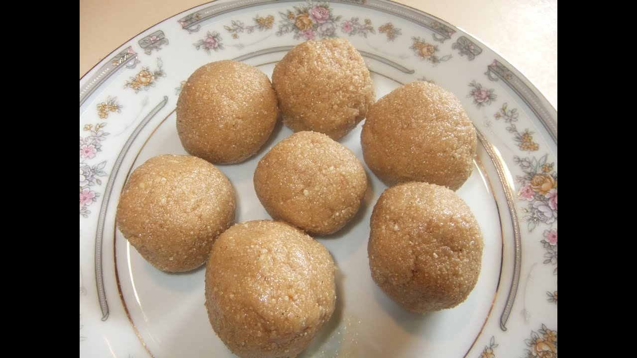 Aggala.(Sweet and spicy rice balls) - YouTube