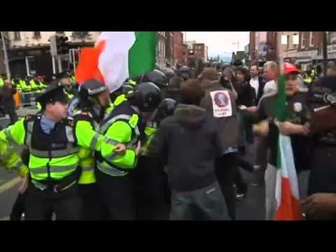 Riot police control violence as Queen visits Ireland