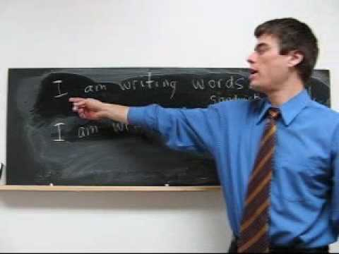 Learn English Lesson 8 - What is he doing? Phone.