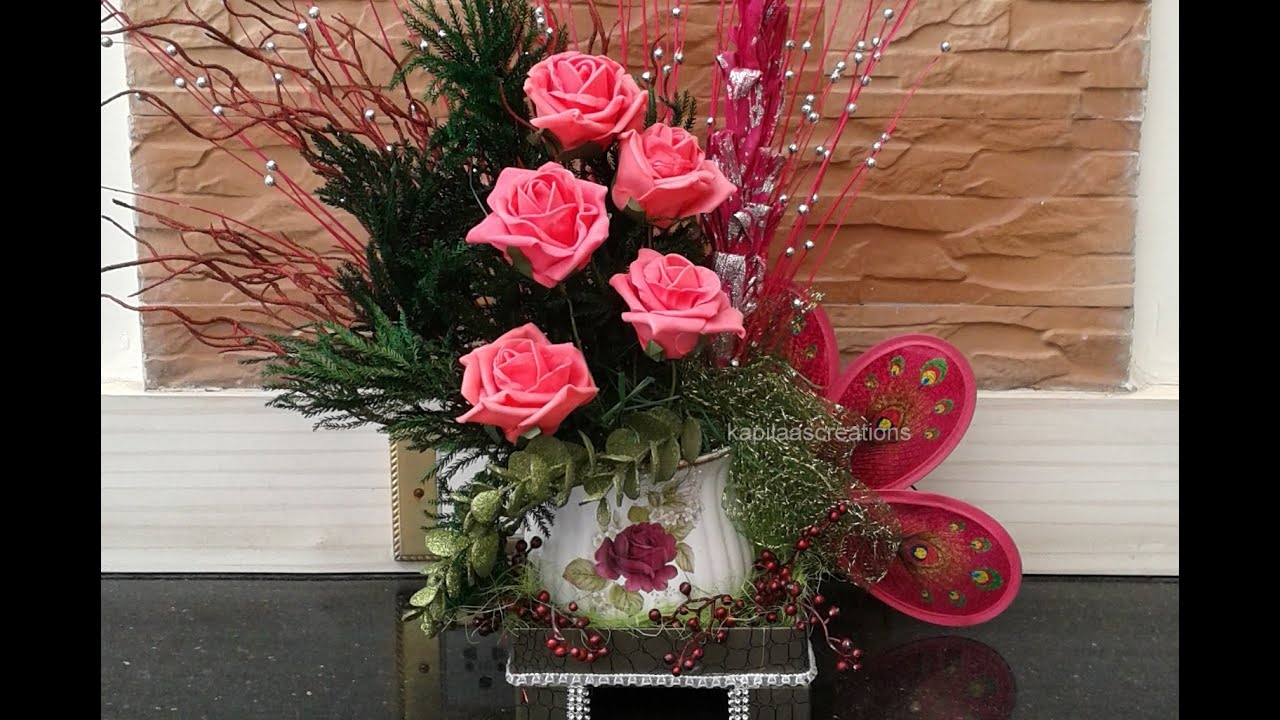 Google Pinkflower And Peacock Flower Arrangement Youtube