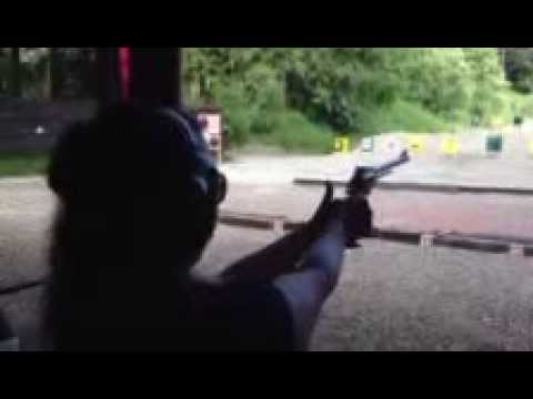 Girl Shooting .50 Cal. Freedom Arms Revolver