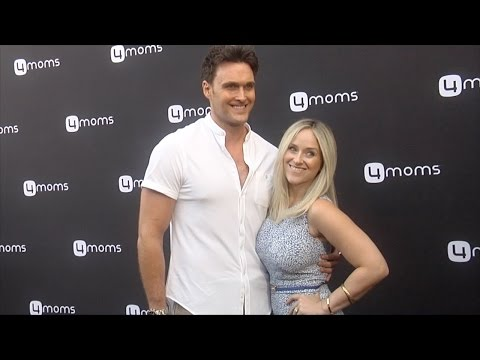Owain Yeoman & Gigi Yallouz 4moms SelfInstalling Car Seat Launch Black Carpet