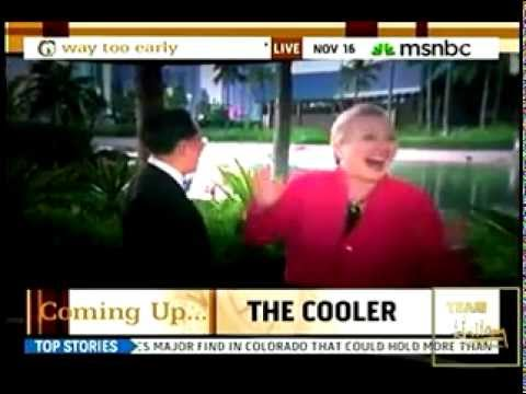 SECY OF STATE HILLARY CLINTON GETS A GOOD LAUGH AT HER HAWAIIAN STREAKER
