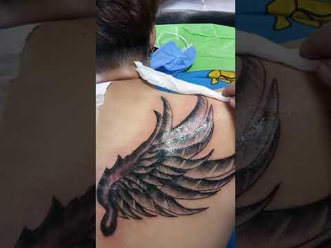 hình xăm đôi cánh.. | Bao quát những kiến thức liên quan hình xăm đôi cánh ở lưng đúng nhất