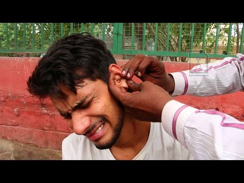 Roadside Ear wax cleaner : Painful way to remove dirt and gu