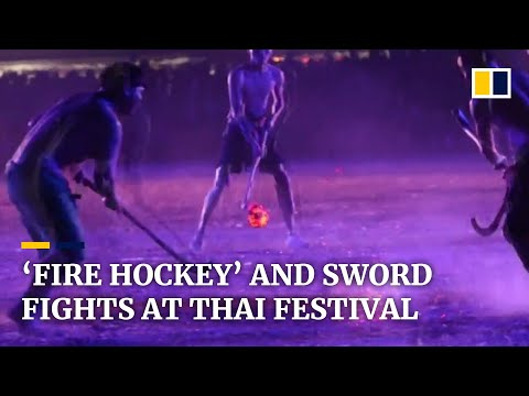 'Fire hockey' and sword fights are hot events at cultural festival in Thailand