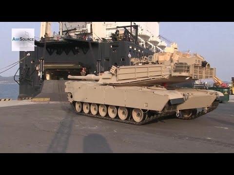 U.S. Marines Equipment Off Load. M1 Abrams & Humvee.