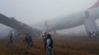 Plane skids off runway, shuts down international airport