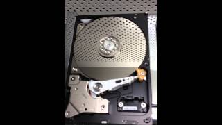 Hard Drive parts repair in Class 100 clean room environment