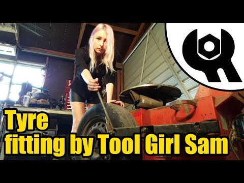 #1830 - Tool girl Sam fits a new car tyre