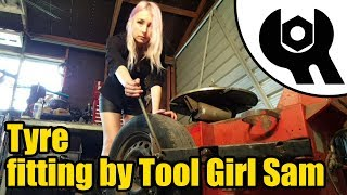 Tool girl Sam fits a new car tyre #1830