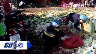 Hiểm họa công nhân ăn rau nhặt từ bãi rác   VTC