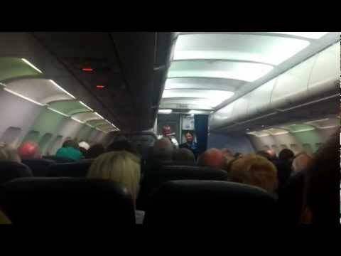 Captain Of Thomas Cook Flight Talking To Passengers About Problem With In Flight Meals