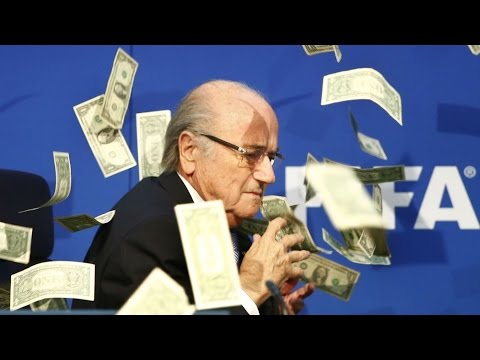 Sepp Blatter Showered in Fake Money by British Comedian