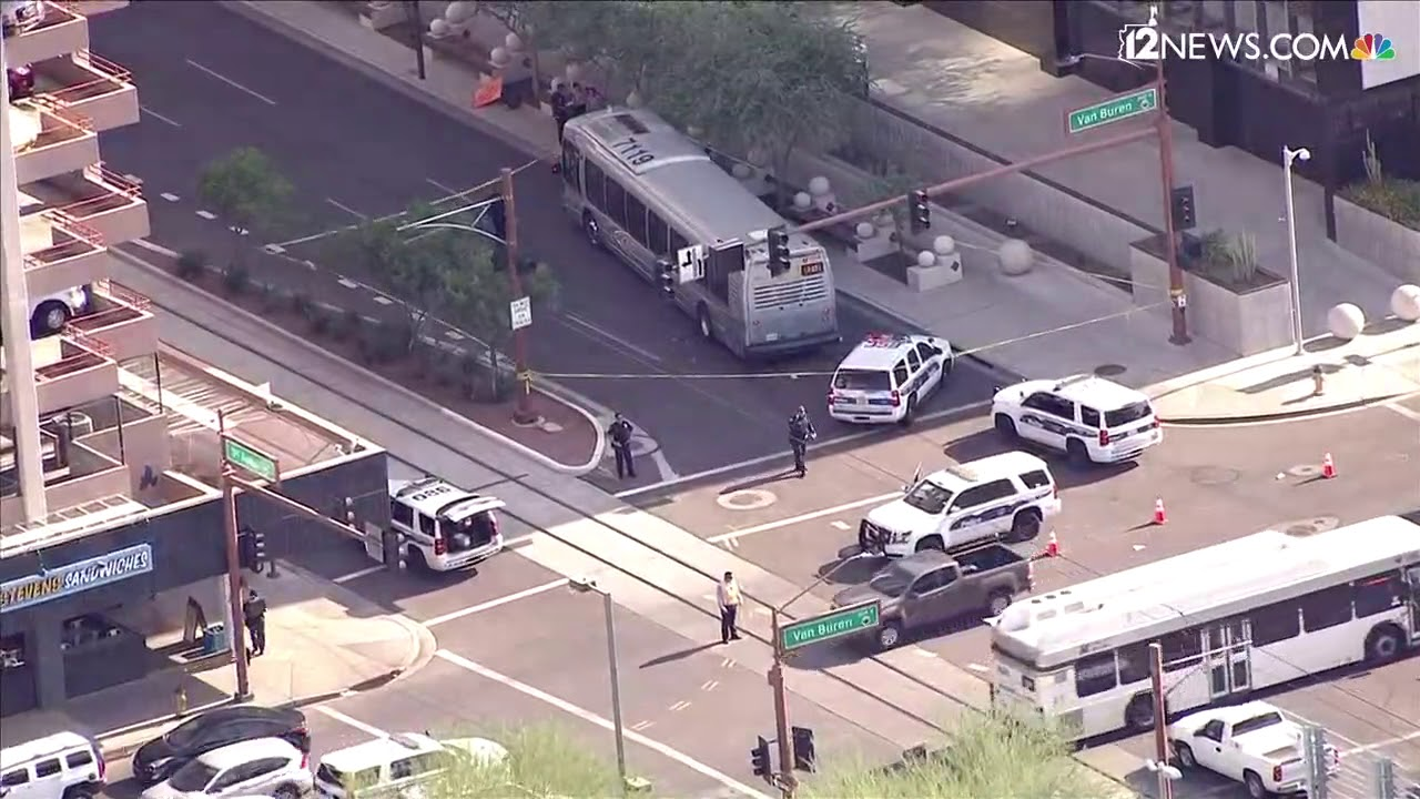 Phoenix City bus hits pedestrian at 1st Ave  and Van Buren