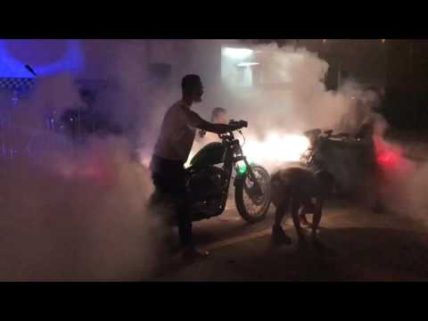 Bruder and Frend twin burnout and flames at opening Ibiza Motor Monkey's Garage