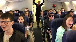 Plainfield North choir sings on a plane