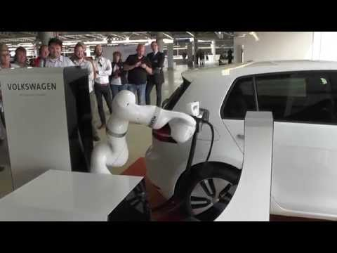 VW Robot Car Charger - robot valet refuels your car while you shop