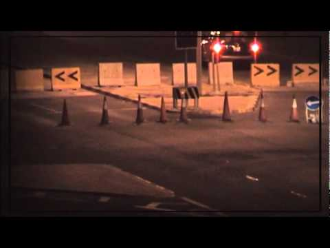 The Bahrani regime's armed militias are next to the barrier between A'ali and Riffa.wmv
