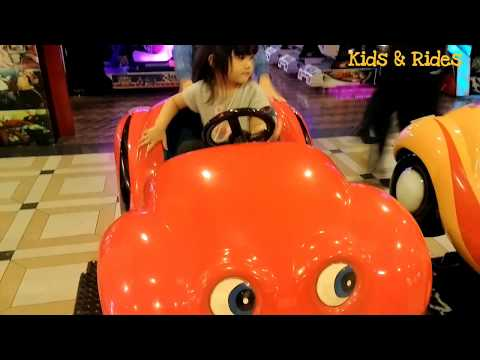 red-buggy-power-wheels-car-rides-for-kids,-little-girl-driving,-odong-odong-mobil-in-mall