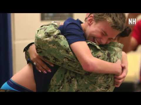Navy mom reunites with son at Mowat Middle School