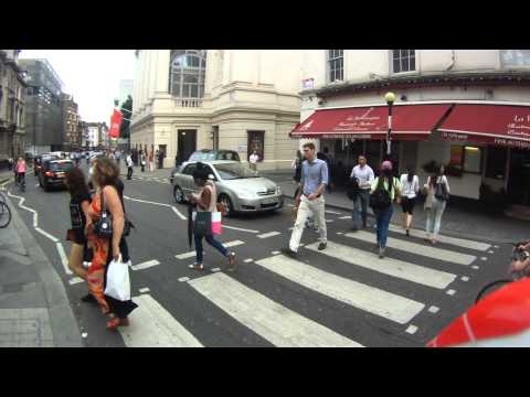 Cyclists Ignoring Pedestrians At Zebra Crossing