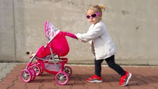 Little Girl Elis Pushing Toy Stroller with her Baby Doll - Outdoor Activity with Brother Thomas