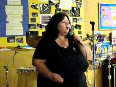 Liz singing karaoke at the Soup Kitchen BYOB