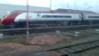 Virgin Trains Pendolino passing Wapping sidings