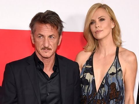 Penn and Theron Hand-in-hand on 'Gunman' Carpet
