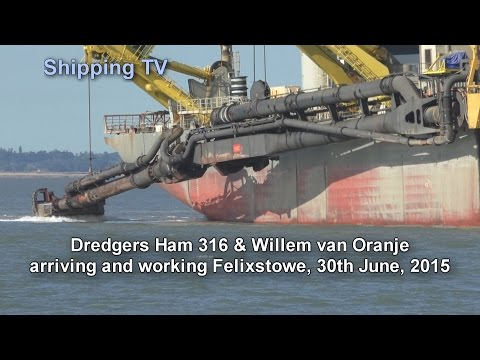 Dredgers Ham 316 and Willem van Oranje at work . .