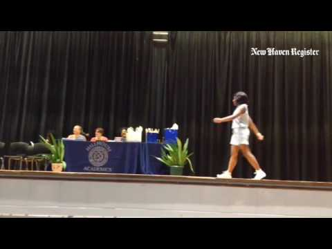 Quiana Copeland receives two awards at the James Hillhouse High School Senior Awards Ceremony.