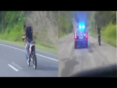 HOMBRE EN MOTORA SE ESCAPA DE LA POLICIA DE CAMINO ADJUNTA