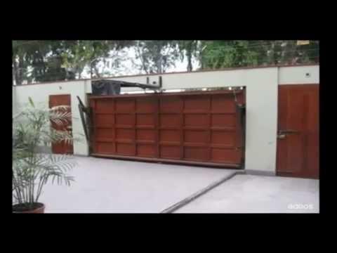 Puertas de garaje levadizas seccionarles batientes for Puertas corredizas de metal