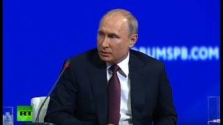 Putin meets with heads of international news agencies at St. Petersburg economic forum