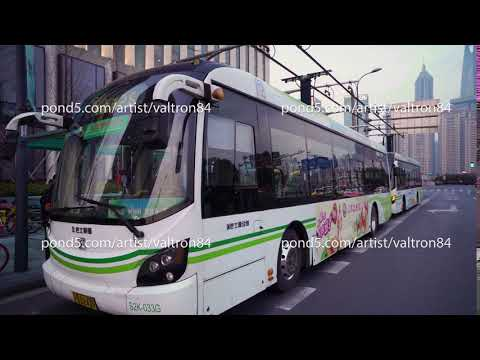 Shanghai, China - January 15, 2018: Electric powered hybrid bus charging on street