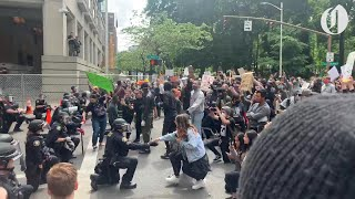 Portland Police take a knee with protesters