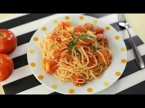 Angel Hair With Basil Leaves In Tomato Sauce
