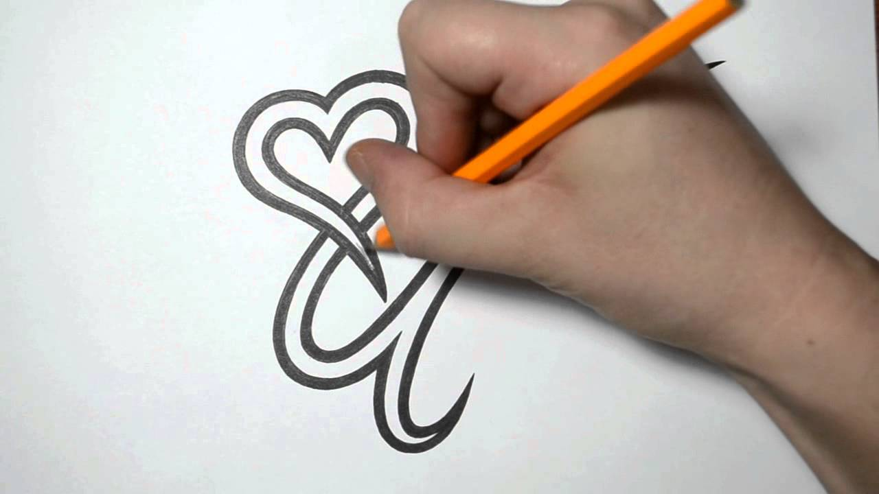 letter u and heart combined tattoo design ideas for