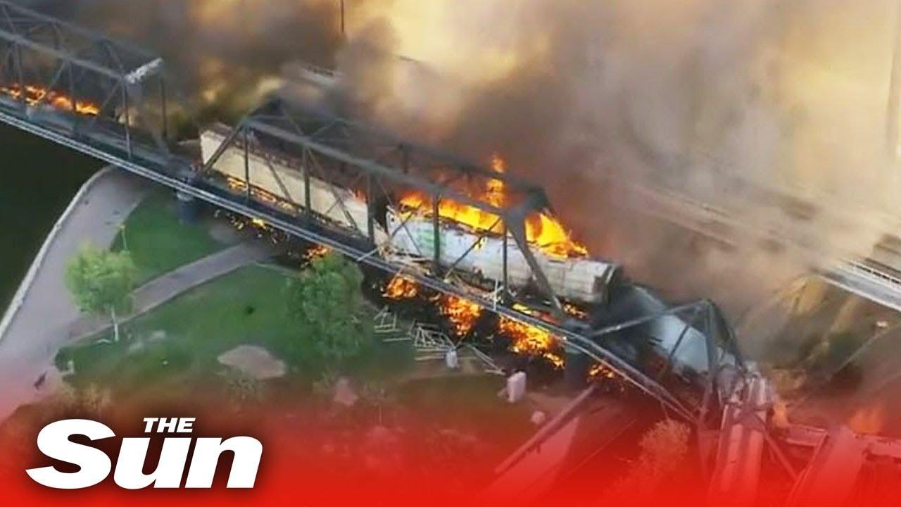 Train carrying hazardous materials derails, catches fire on bridge ...